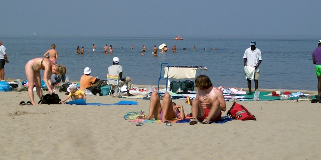Sunbathing on the wide sandy beach in Lido di Spina, Emilia Romagna