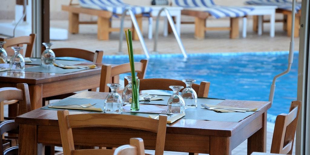 Dine right next to the pool at La Terra dei Sogni