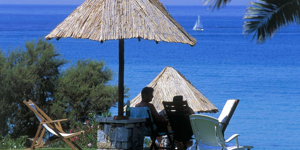 Relaxing under your umbrella at Europes most stunning beaches