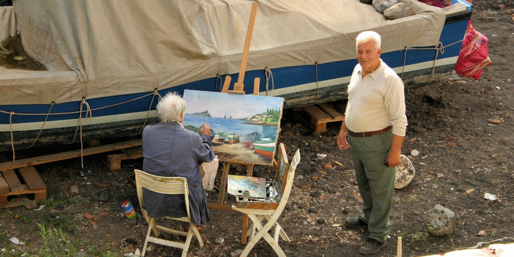 Målare på stranden på Sicilien