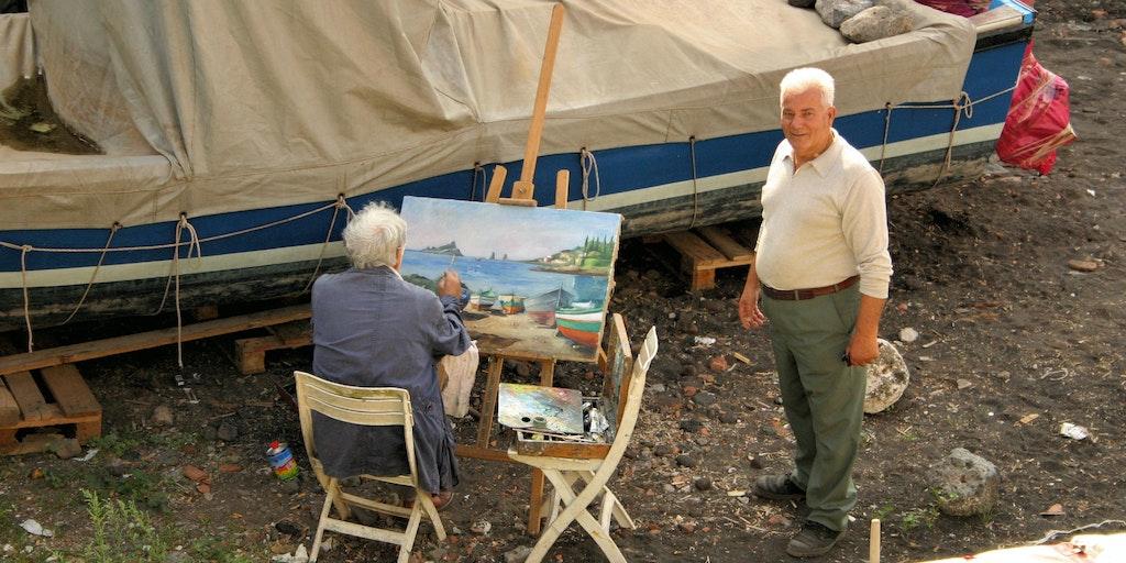 Maler am Strand auf Sizilien