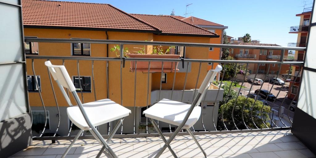 Une des chambres avec balcon