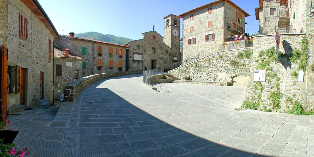 The village square with restaurant,  reception is a few steps down to the left