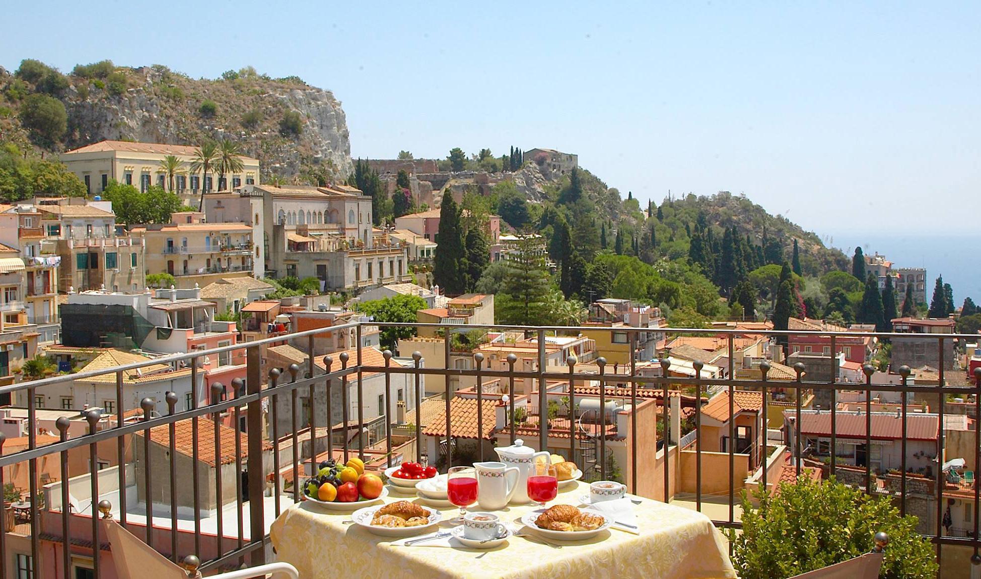 Giardini taormina and castelmola city touru get our tour from catania