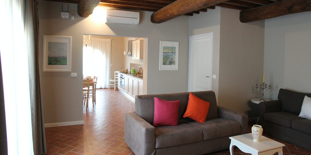 Vardagsrum i lägenheten Gelsomino