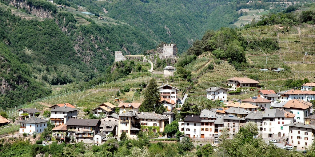 Locanda dello Scalco is at the centre of the picture behind the village and in front of the castle