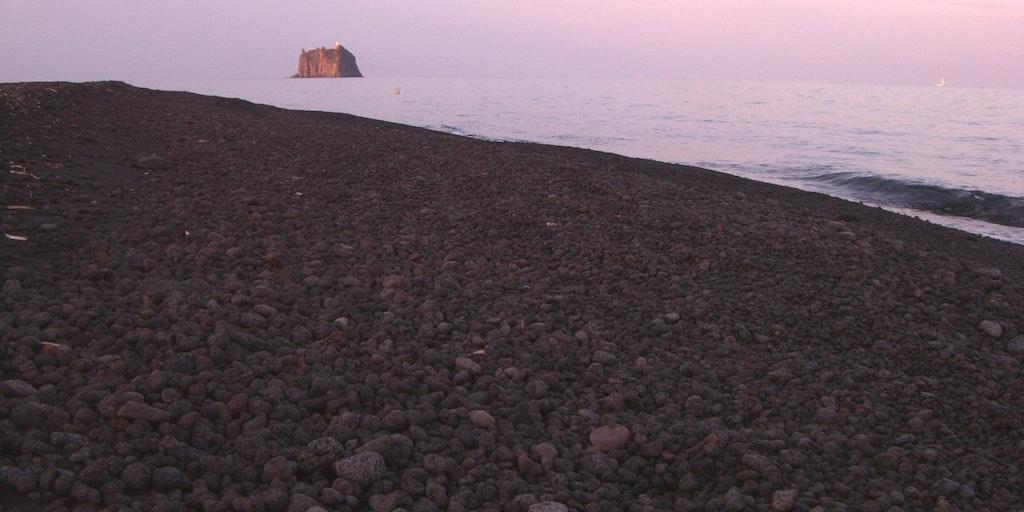 Strombolicchio in evening twilight seen from Stromboli's black beach
