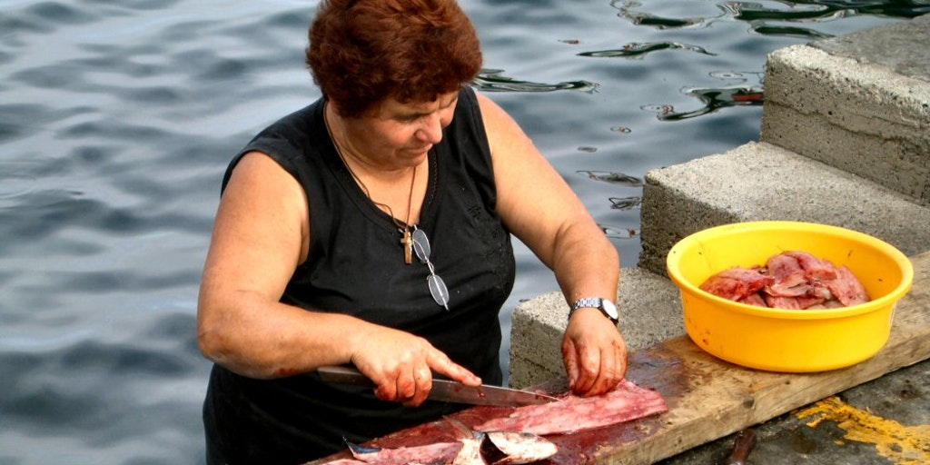 Fisherman's wife preparing the day's catch