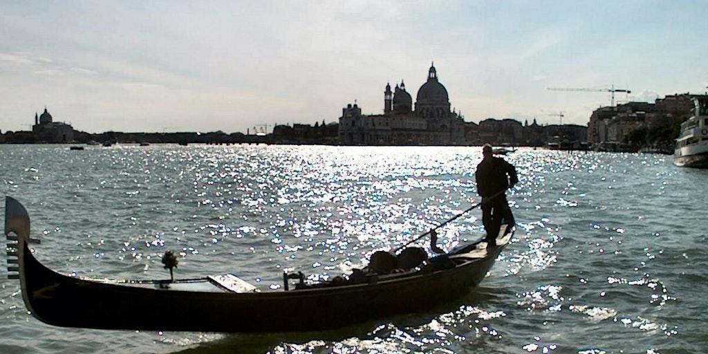 Cross the lagoon by gondola