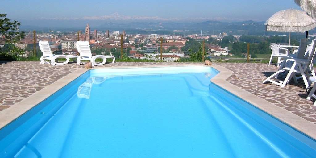 Swimming pool overlooking the Alba, the vineyards and the Alps in the background