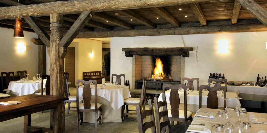 Restaurant with fireplace and panoramic mountain views