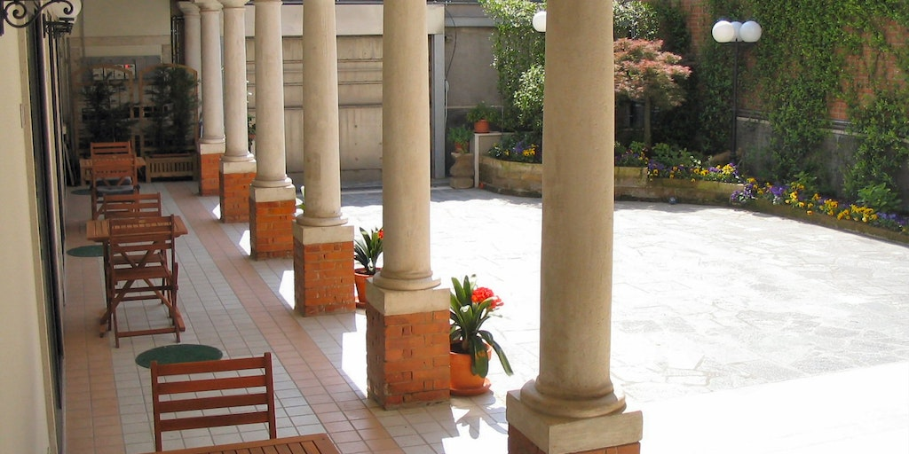 All three rooms have a private terrace under the colonnade