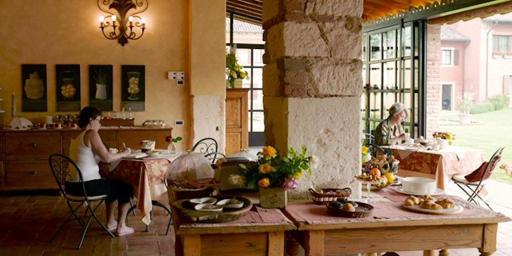 Breakfast room overlooking the farm's olive trees