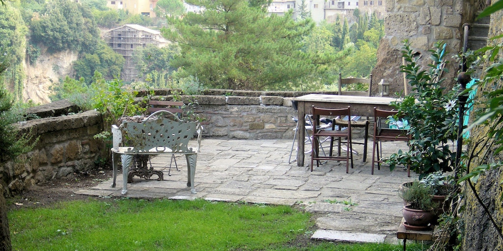 <p>The terrace and garden overlooking the valley</p>