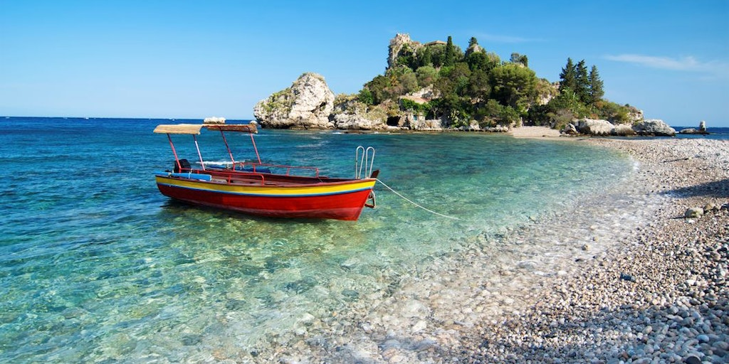 The small island of Isola Bella and pebble beach