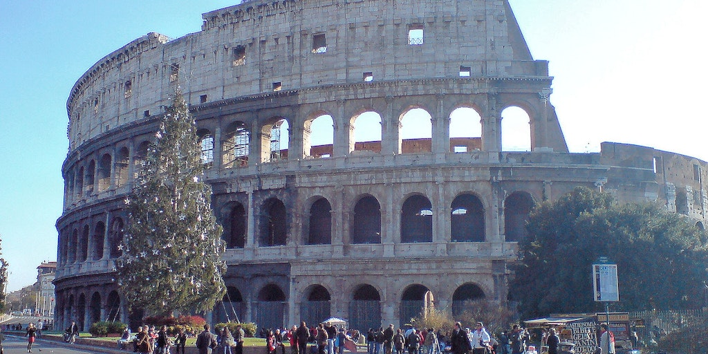 Colosseum and the Christmas tree in sunny weather