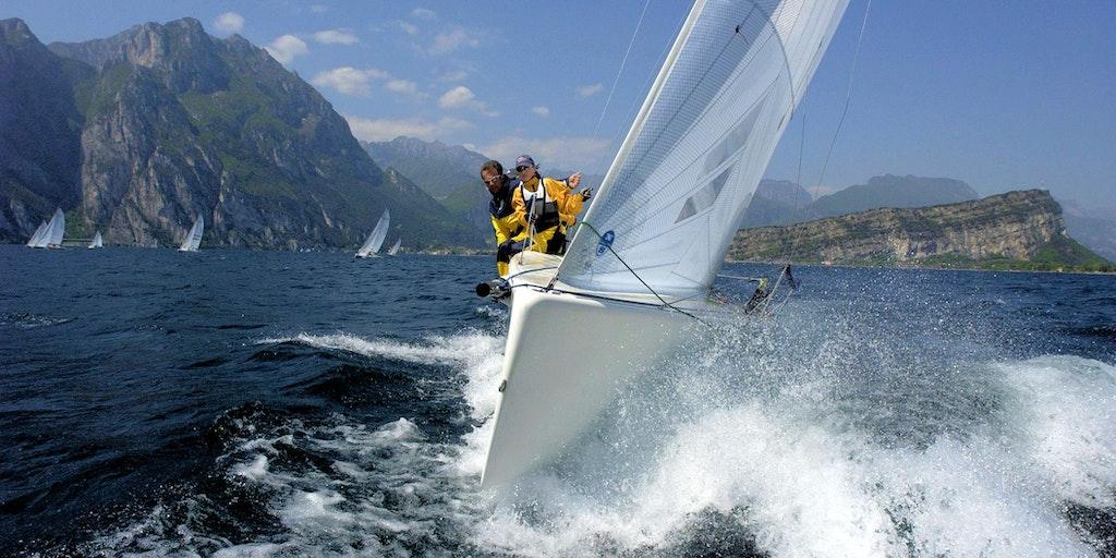 Skipper on Lake Garda between Torbole and Riva del Garda in the background